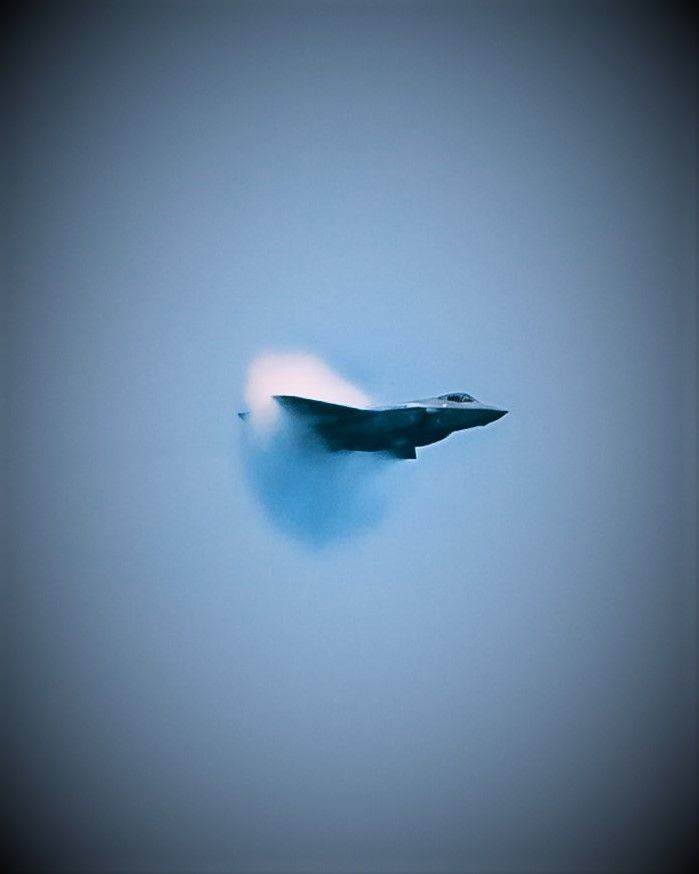 Sonic boom with a shock wave behind an airplane